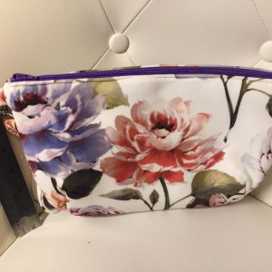Floral clutch purse with purple zipper