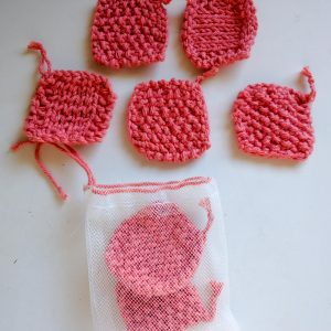 Hand-knit face scrubbies – coral